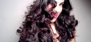 Curl your hair into voluptuous curls with a flat iron