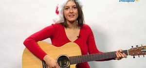 "Play the classic ""Feliz Navidad"" on your guitar for the holiday season"