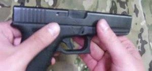 Disassemble and reassemble a Glock 17 handgun