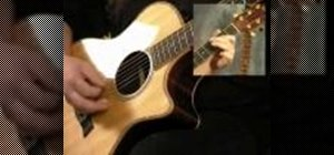 Learn blues progressions on an acoustic guitar