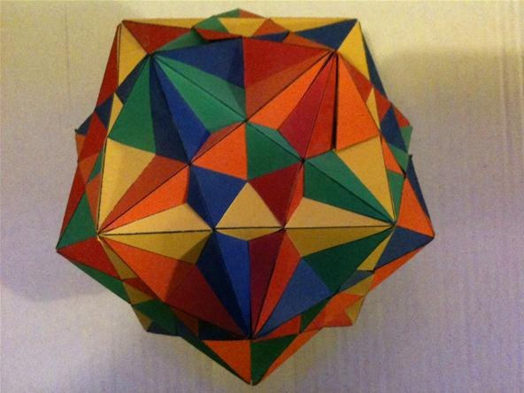 realised that this shape is basically 5 intersecting cubes. Below is