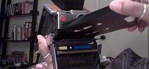 Load 600 film into a Polaroid SX-70 camera