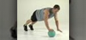 Tone abs with a medicine ball hand walk exercise
