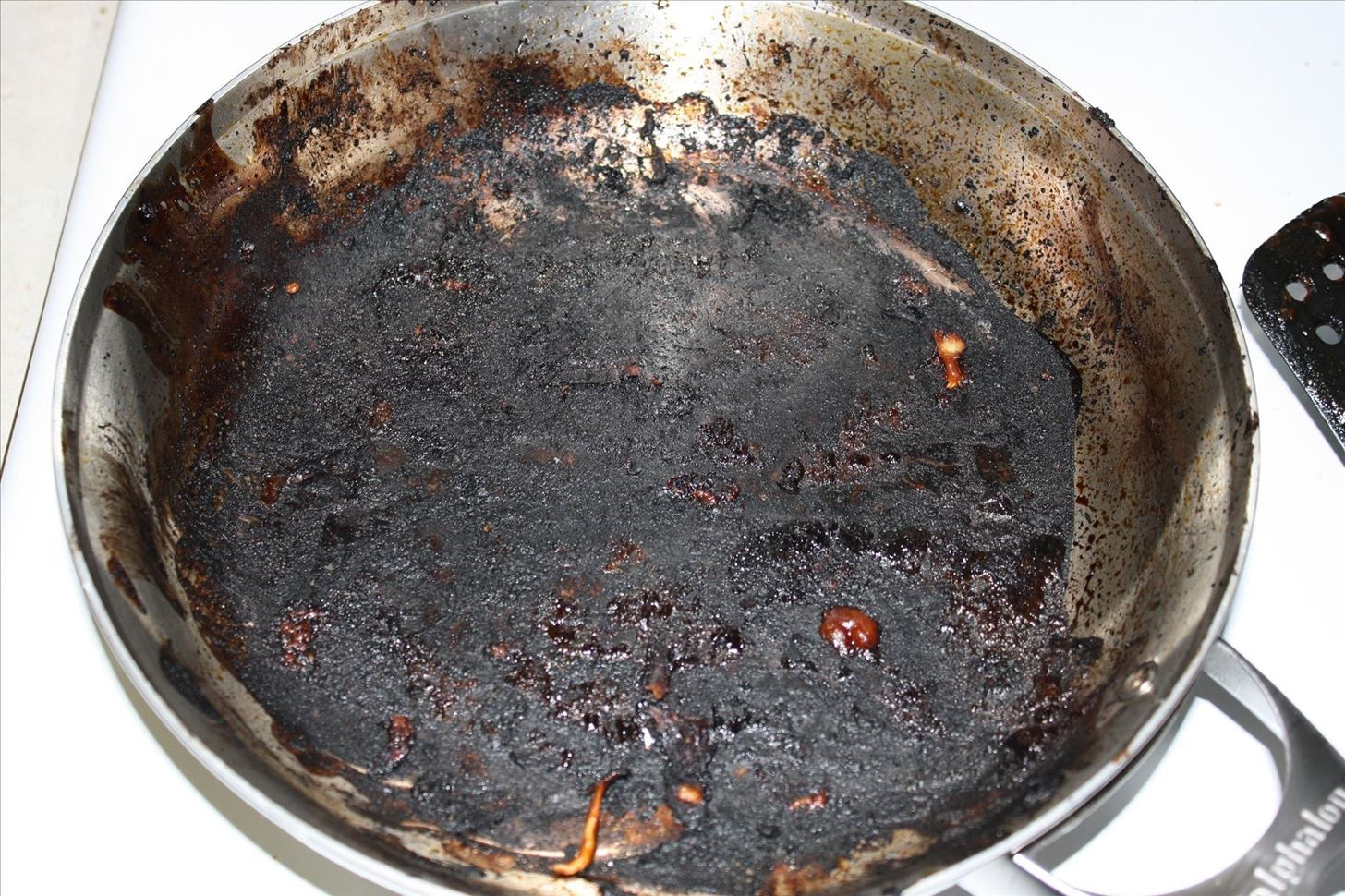 How to clean uncleanable scorched spots from pots pans food hacks daily - Clean burnt grease oven pots pans ...