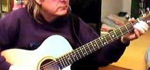 Play John Lee Hooker style blues riff on the guitar