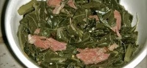 Cooked southern collard greens with turkey legs