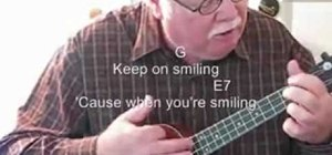 "Play Louis Armstrong's ""When You're Smiling"" on the ukulele"