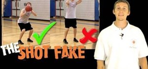 Perform a shot fake in basketball
