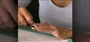 Apply white tips to nails in a French manicure