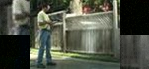 Use a pressure washer to clean wood fences