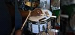 Play the Ndugu cross stick beat on the drums