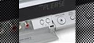 Set English as the language on a Panasonic DMR-EH55