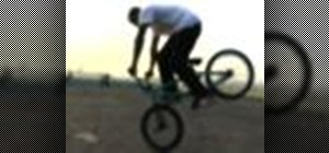 Perform a foot jam endo on a BMX bicycle