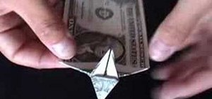 Origami a dollar bill dog