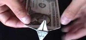 Origami a dollar bill dog