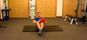Do the medicine ball twist to tone abs and side obliques