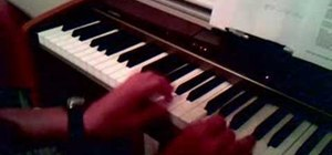 "Play ""Imagine"" by John Lennon on piano"