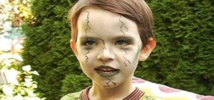 Create a scary green zombie look for a little kid for Halloween