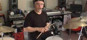 "Play ""Satisfaction"" by the Rolling Stones on the drums"