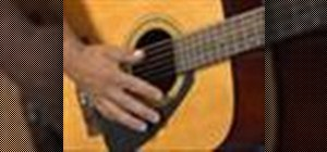 Play an EAB chord progression on the guitar