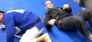Do the rear jump to arm-bar attack in jiu jitsu