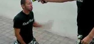 Do a Krav Maga gun to the head while kneeling defense