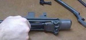 Disassemble a M-1 Garand rifle