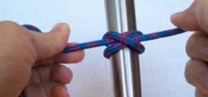 Tie a clove hitch knot