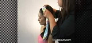 Tie on a scarf like Brigitte Bardot to fix a bad hair day