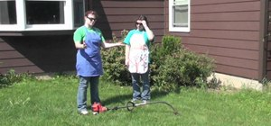 Use a weed whacker to trim the weeds in your yard