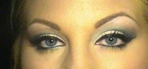 Apply MAC 34 fake eyelashes