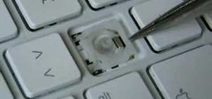 Re-assemble a key on an Apple MacBook keyboard