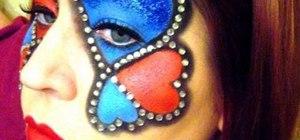Apply Queen of Hearts inspired costume makeup