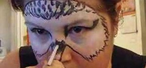 Apply Harry Potter's Hedwig face paint