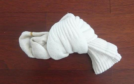 """How You Should Really """"Fold"""" Socks to Prevent Stretching Them Out"""