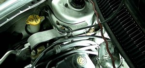 Remove an alternator from a Dodge Neon