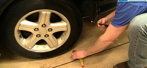 Fix a flat tire on a car or truck
