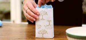Recycle old envelopes into bags for small holiday gifts