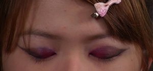 Create an extravagant Wa Lolita makeup look with red false eyelashes