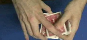 Properly hold a deck of playing cards for card tricks
