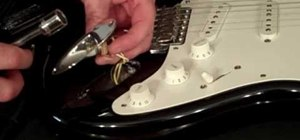Tighten the cable input jack on a Stratocaster