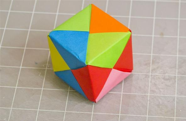 This post/video shows how to make this origami cube in more detail.