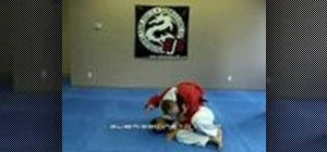 Escape a head lock using a suetmi Jiu Jitsu throw