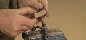 Polish the bolt on a bolt action rifle