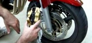 Replace brake pads on a motorcycle