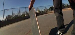 Do a standard kickflip on a skateboard