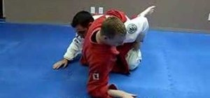 Do a Jiu Jitsu Kimura sweep