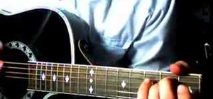 "Play George Strait's ""Troubadour"" on acoustic guitar"