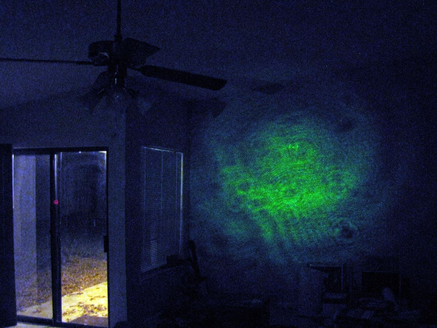 How to Build Your Own Projection Microscope with a Syringe, Laser Pointer, and Drop of Water