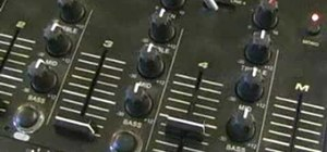 Use the EQ, bass, mid and treble on a DJ mixer